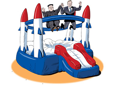 Kim and Moon bouncing on a inflatable trampoline that looks like rockets